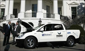 President Bush inspecting an electric vehicle on the White House Lawn