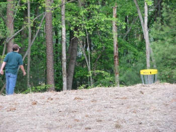 Brother playing hole one at Westwood park's new disc golf course