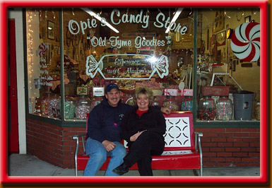 Owner's Freddie and Carolyn sitting outside of Opie's