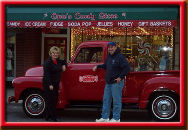 Owner's Freddie and Carolyn standing out on Main Street next to their vintage pickup